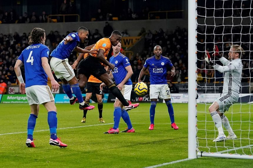 Wolverhampton Wanderers' Willy Boly scores their first goal which is disallowed by VAR for offside.