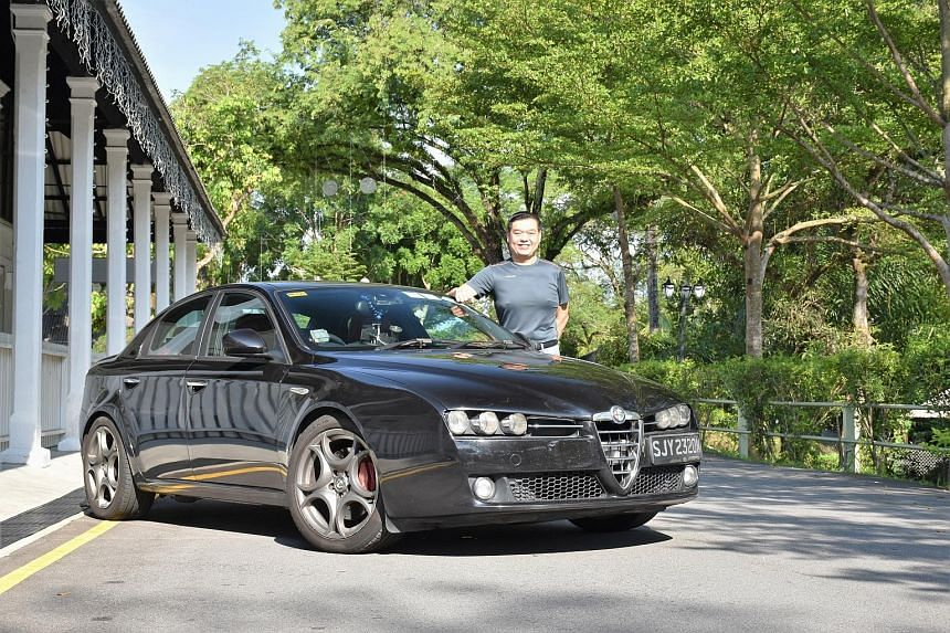 Property agent Elgin Lim, 46, with his Alfa Romeo 159. He says he is keeping his car beyond 10 years because he enjoys driving it, and it is economical to do so.