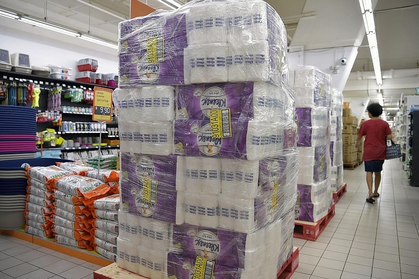 No shortage of toilet paper and rice at Hao megamart at The Grandstand (above).