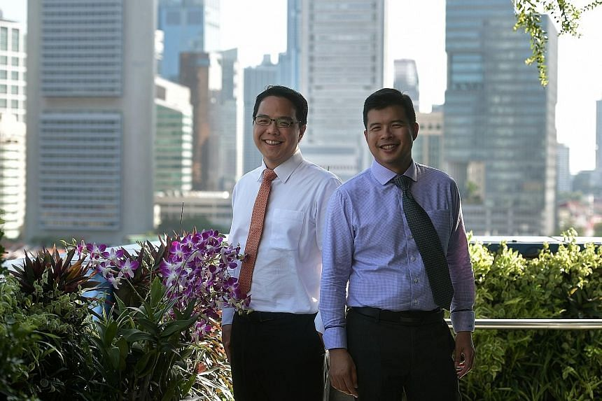 The Ministry of Finance's fiscal policy director Peter Lim (far left) and land and infrastructure programmes director Mark Tan speak about issues such as the Government being able to draw on the nation's reserves only up to a certain point, how incre
