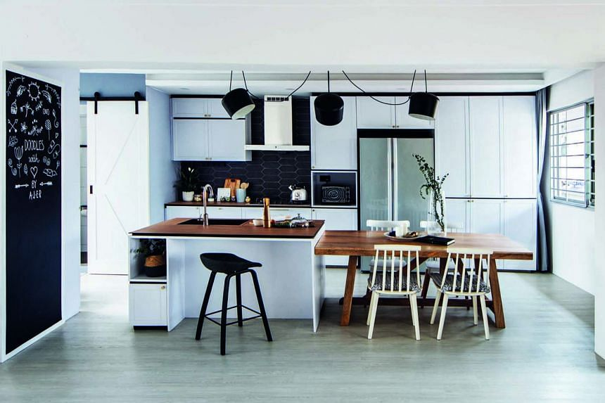 The heart of the home, the kitchen has an island counter that adjoins a table to create more space for dining.
