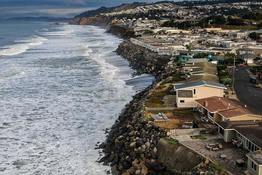 A sea wall (left) surrounding Navotas, a low-lying area of metropolitan Manila, and homes (right) along the coast in Pacifica, California, south of San Francisco. One poor, one rich, Manila and San Francisco face a similar dilemma.