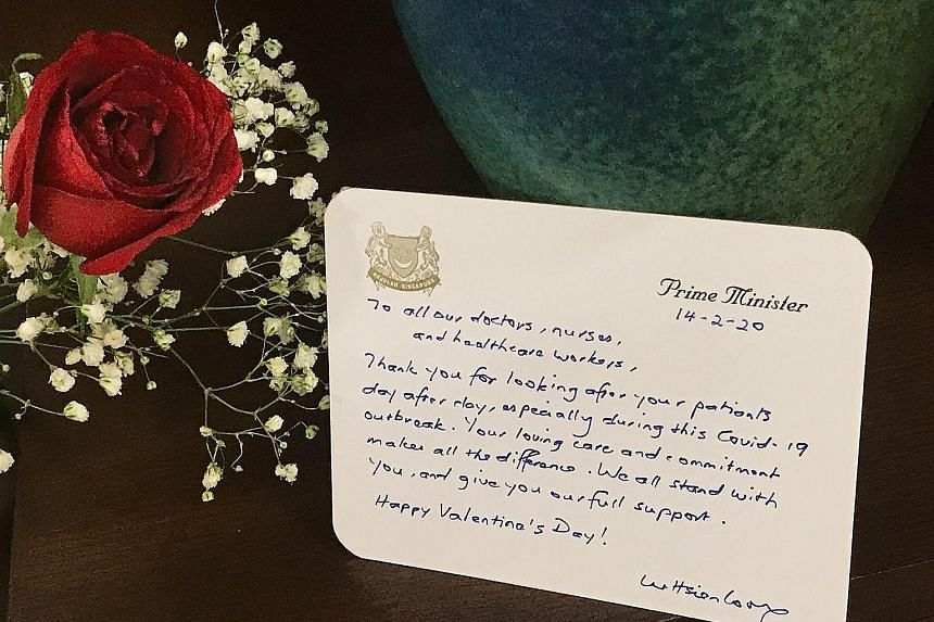 Prime Minister Lee Hsien Loong's Valentine's Day note to healthcare workers, expressing support and appreciation for them. PHOTO: LEE HSIEN LOONG/FACEBOOK Above: Minister for Culture, Community and Youth Grace Fu yesterday with Mr Muhammad Akram Moha