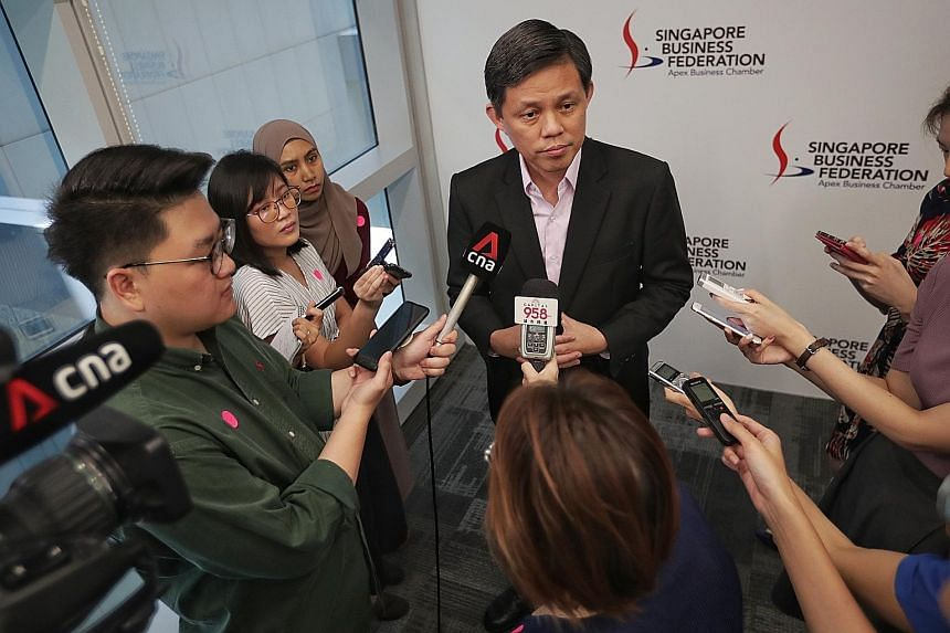 Minister for Trade and Industry Chan Chun Sing addressing members of the media at the Singapore Business Federation Centre yesterday. Mr Chan noted that though the Government can refer to support measures rolled out during past crises, each was diffe