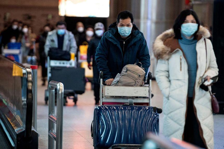 Passengers arriving at Beijing Capital International Airport in Beijing on Feb 2, 2020.