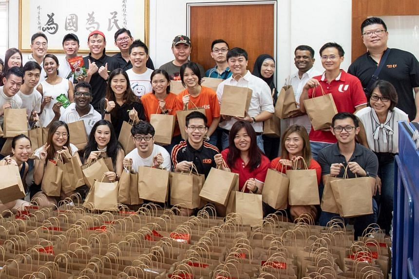 Mr Desmond Choo (standing, second from right), NTUC's assistant secretary-general and PAP member, joined youth volunteers in preparing care packages for healthcare workers.