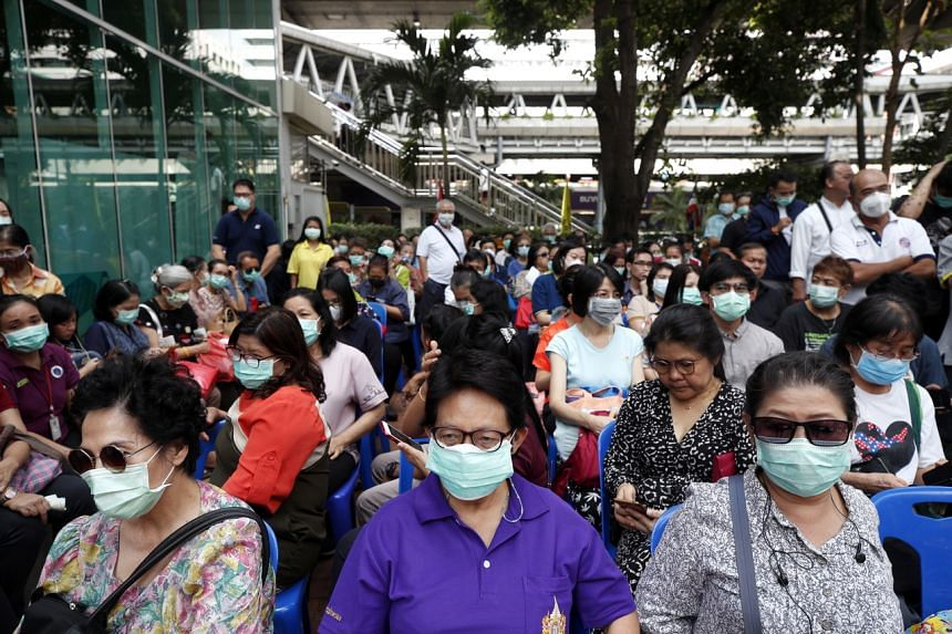 People standing in line to buy protective masks at the Government Pharmaceutical Organisation in Bangkok on Feb 6, 2020.