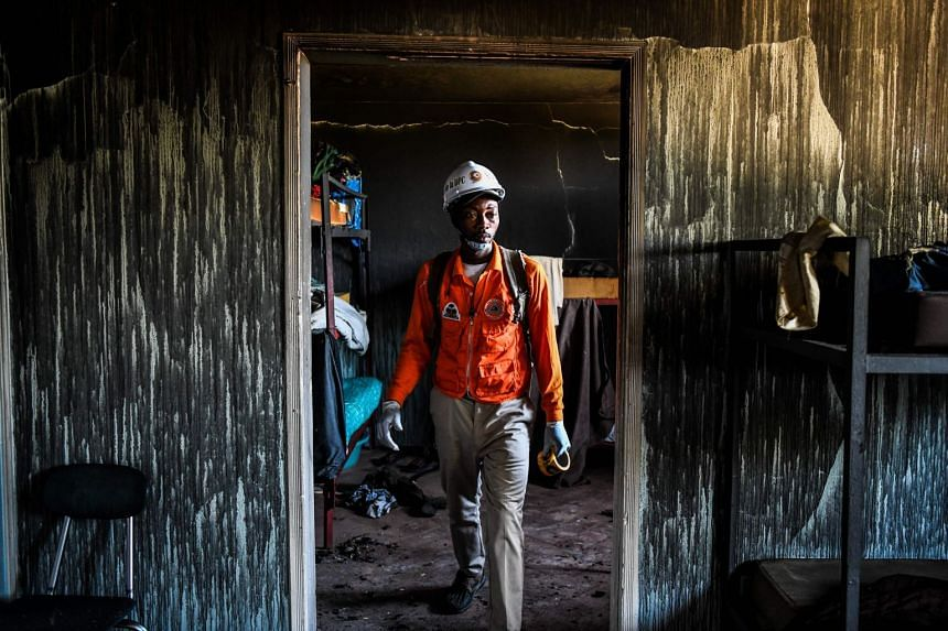 A fireman inspects a room inside the orphanage.
