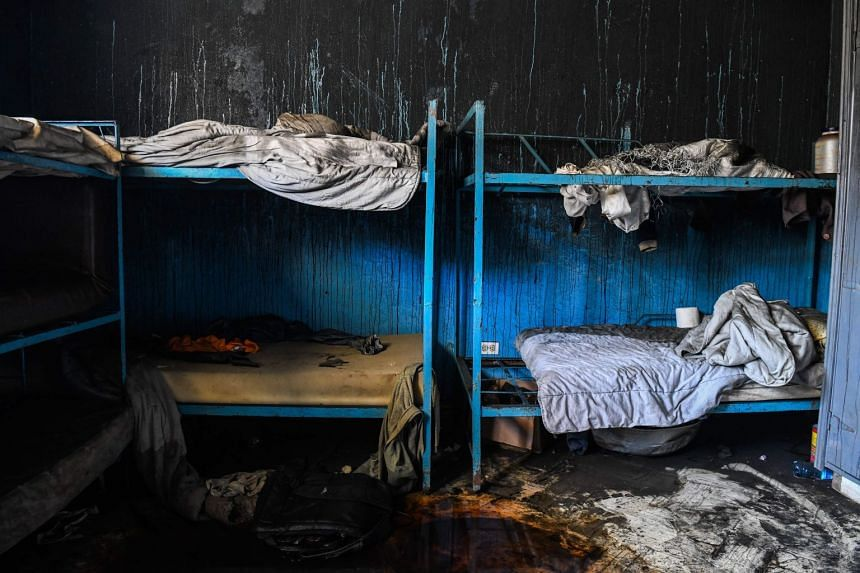 Burned remains are seen in a room inside the orphanage.