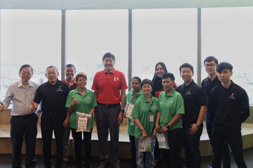NTUC secretary-general and Minister in the Prime Minister's Office Ng Chee Meng (fifth from left) and Batu executive secretary and PAP member Zainal Sapari (third from left) with staff from cleaning company Spic & Span.