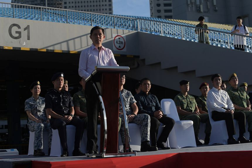 Minister for Trade and Industry Chan Chun Sing speaking at a Total Defence Day event at The Float @ Marina Bay on Feb 15, 2020.