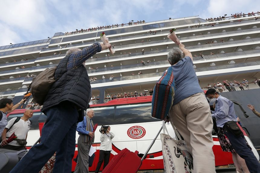 Passengers leaving MS Westerdam after the cruise ship was allowed to dock in Sihanoukville, Cambodia, on Feb 14, 2020.