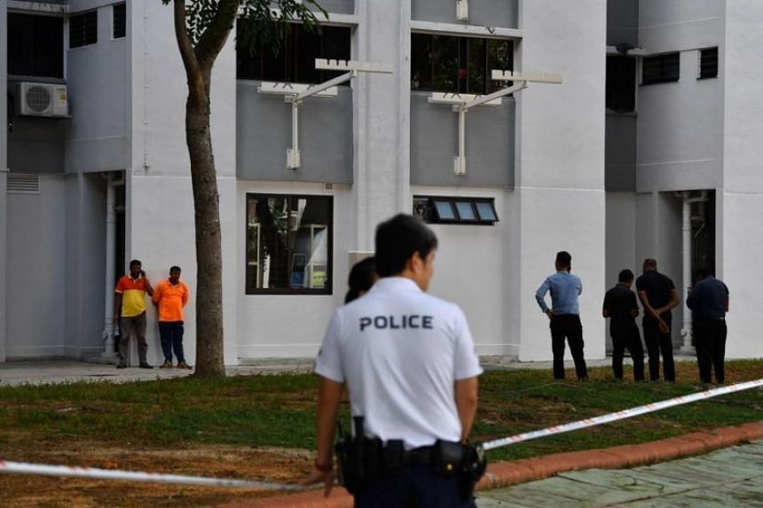 Cleaners and police officers at Block 534 Bedok North Street 3, on Jan 7, 2020, where a baby boy was found abandoned in a rubbish chute.