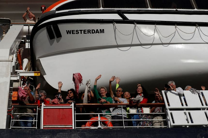 Passengers on board MS Westerdam, which was allowed to dock in Sihanoukville, Cambodia, on Feb 14, 2020, after five other countries refused to let the cruise ship into port.