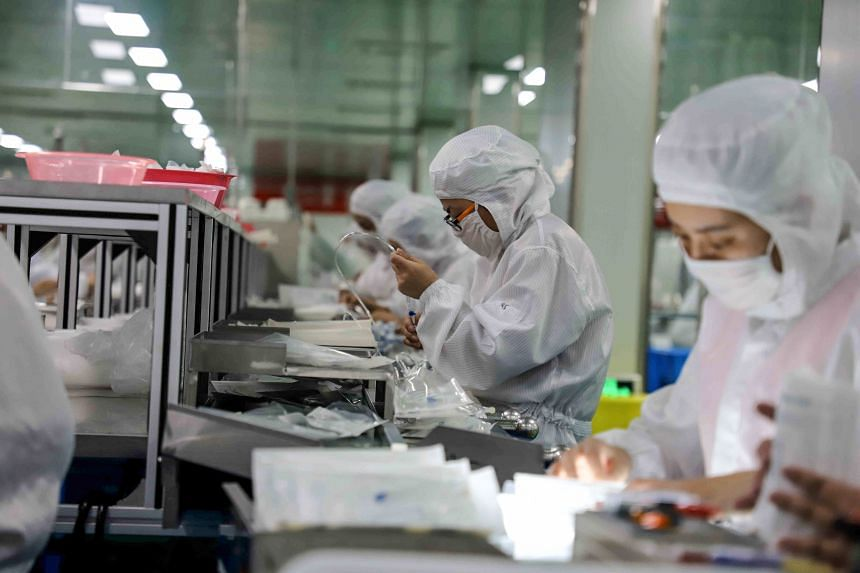 Workers at a medical supplies factory in Binzhou, China, on Feb 13, 2020. China will maintain its prudent monetary policy, a central bank official said on Saturday (Feb 15).