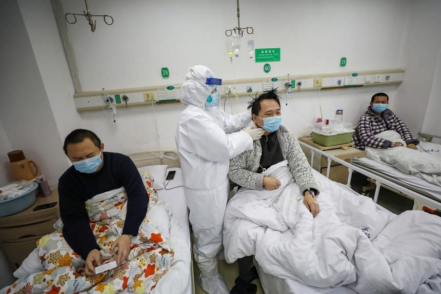 A doctor checking the condition of patients at Jinyintan Hospital in Wuhan, China, on Feb 13, 2020.