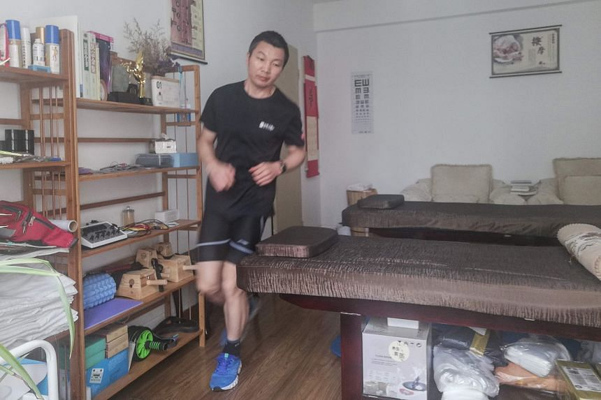 Jogger Pan Shancu running in his bedroom in Hangzhou, China, on Feb 14, 2020.