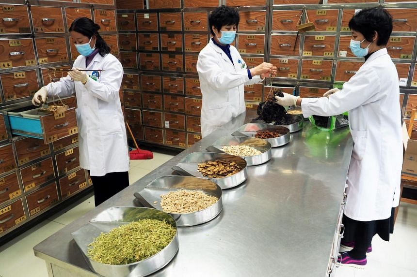 Medical workers preparing traditional Chinese medicine (TCM) on Feb 5, 2020, at a TCM hospital in Binzhou, Shandong province, China.