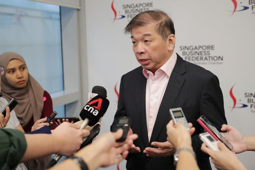 Singapore Business Federation chairman Teo Siong Seng speaks with members of the media on Feb 14, 2020.