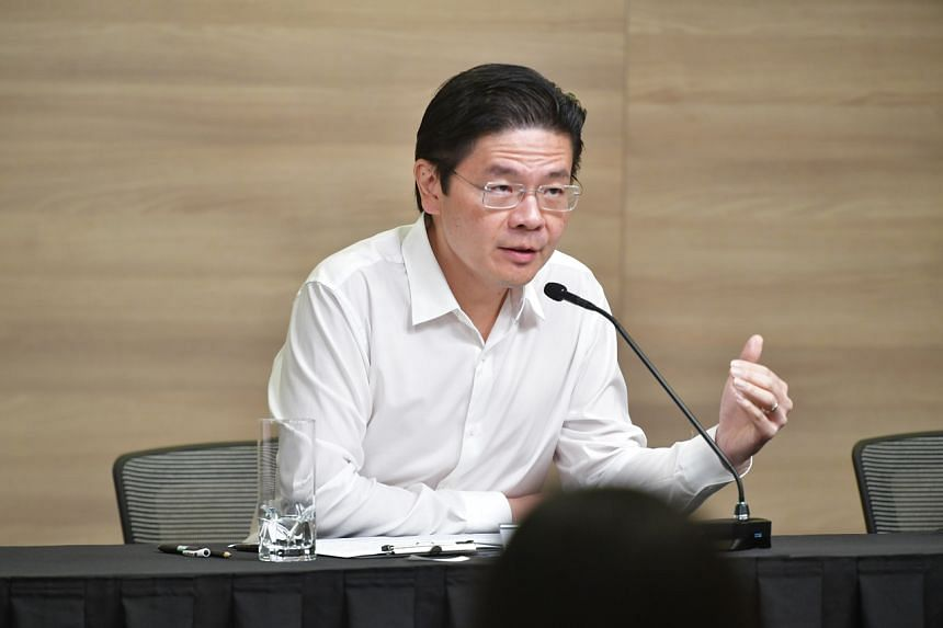 National Development Minister Lawrence Wong speaks during a press conference on Feb 12, 2020.