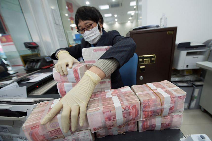 China cleans, locks away currency notes to stop virus spread