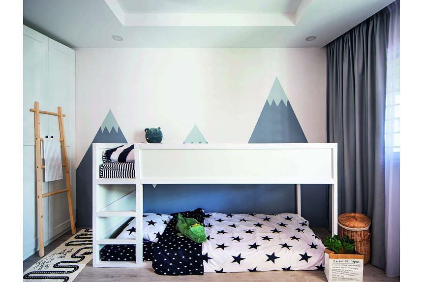 A mural of snow-capped mountains in the children's bedroom (above) conjures up dreams of adventure.