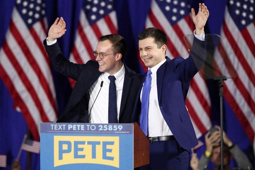 Pete Buttigieg (right) on stage with his husband, Chasten Buttigieg, in Nashua, New Hampshire.