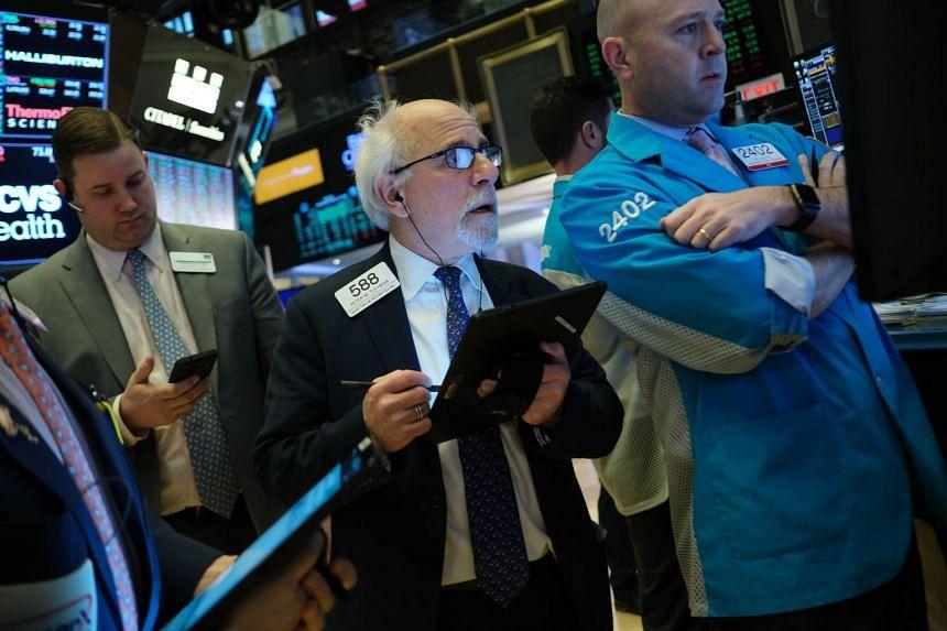 Traders work on the floor of the New York Stock Exchange on Feb 12, 2020.