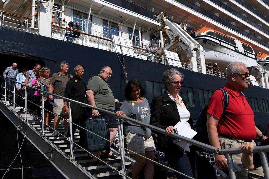 Passengers disembarking from the Westerdam cruise ship in Sihanoukville, Cambodia, on Feb 15, 2020.