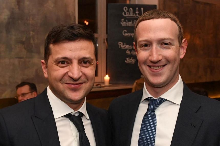 Ukrainian President Volodymyr Zelensky (left) meets Facebook chief Mark Zuckerberg on the sidelines of the annual Munich Security Conference in Germany, Feb 15, 2020.