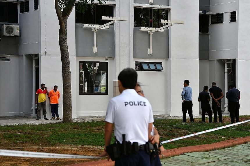 Police officers investigating the area at Block 534 Bedok North Street 3, where the baby boy was found abandoned in a rubbish bin chute by cleaners on Jan 7.