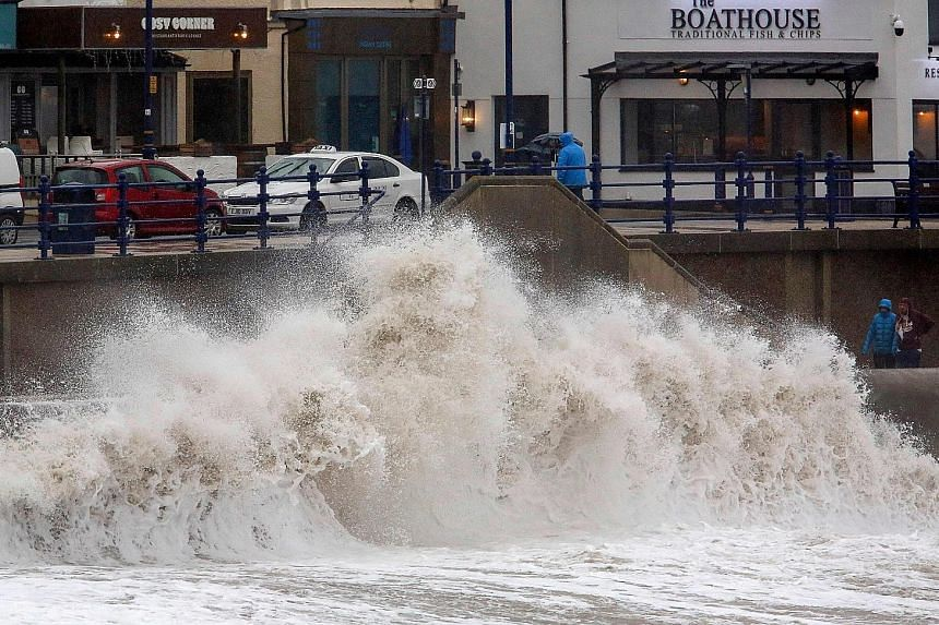 Second major storm brings floods, travel chaos to Britain