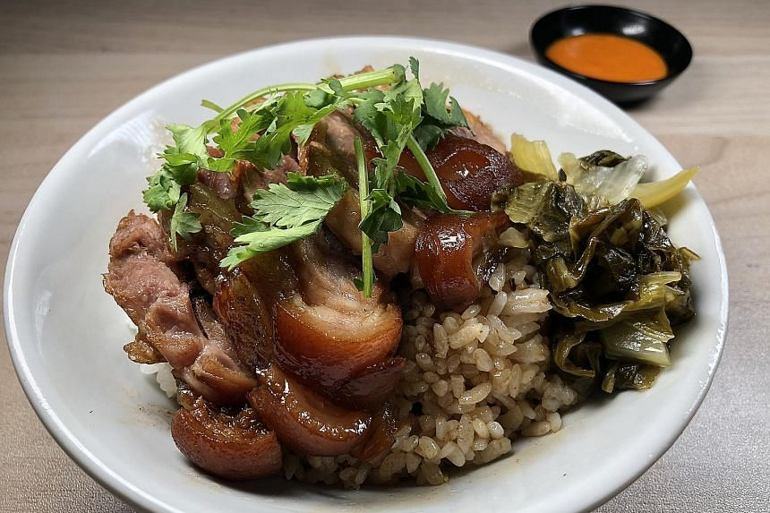 The Pig Trotter Rice (above) is a bowl of short-grain rice topped with a choice of pig trotter meat or pig feet, salted vegetable and meat cake.