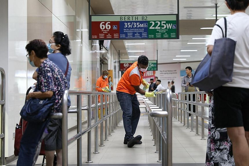 Cleaning of facilities at Bedok Interchange (left) and at Tanah Merah MRT station (far left). Senior Minister of State for Transport Janil Puthucheary said there has been no change in the service quality of train and bus operators despite the need fo