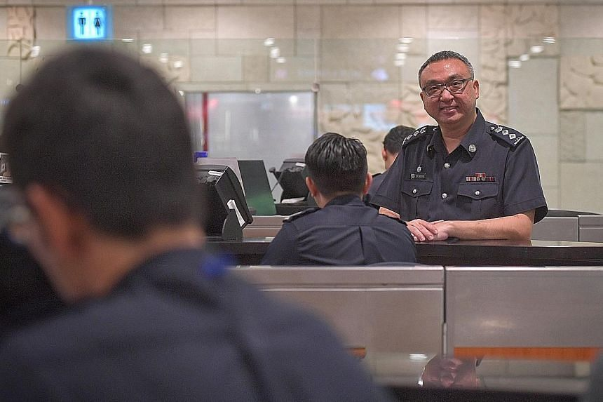 Superintendent Toh Lai Keng, Deputy Commander (Ground Operations), Airport Command, with a screening officer at the checkpoint for arrivals at Changi Airport's Terminal 3. ST PHOTO: ARIFFIN JAMAR