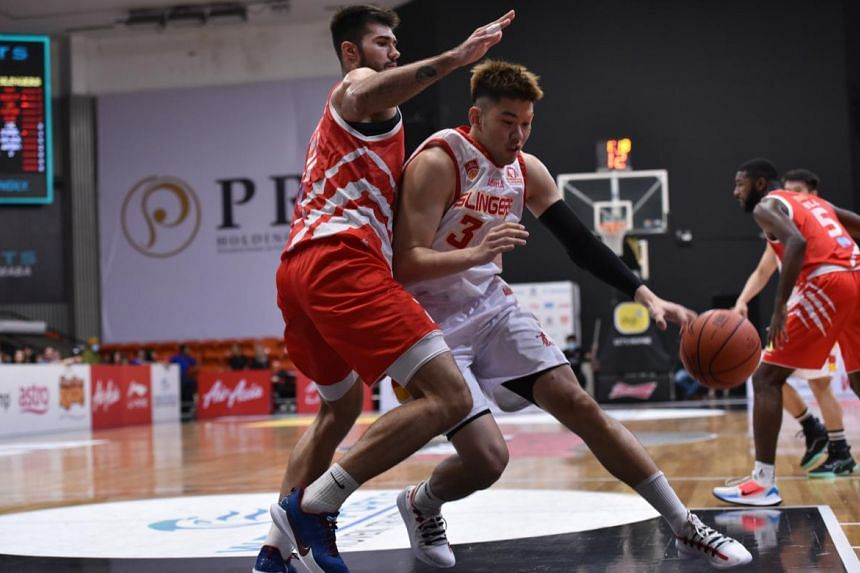 Singapore Slingers forward Delvin Goh (in white) in action against the Kuala Lumpur Dragons, on Feb 16, 2020.
