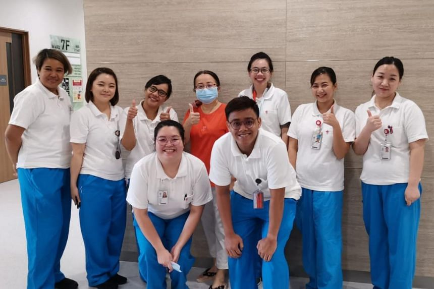 NCID staff bidding farewell to Mrs Zhang (in orange), who has been cleared of the coronavirus.