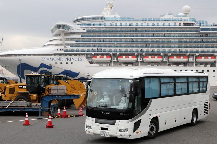 A bus believed to be carrying elderly passengers of the Diamond Princess cruise ship leaves the Daikoku Pier Cruise Terminal in Yokohama, Japan, on Feb 14, 2020.