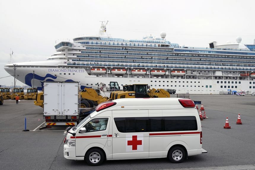 An ambulance, believed to be carring an infected passenger of the Diamond Princess cruise ship, leaves the Daikoku Pier Cruise Terminal in Yokohama, Japan, on Feb 14, 2020.