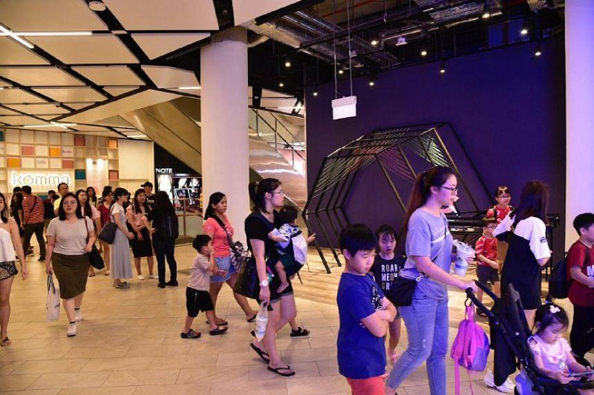 Shoppers at the PLQ Mall near Paya Lebar MRT Station, on Feb 16, 2020.