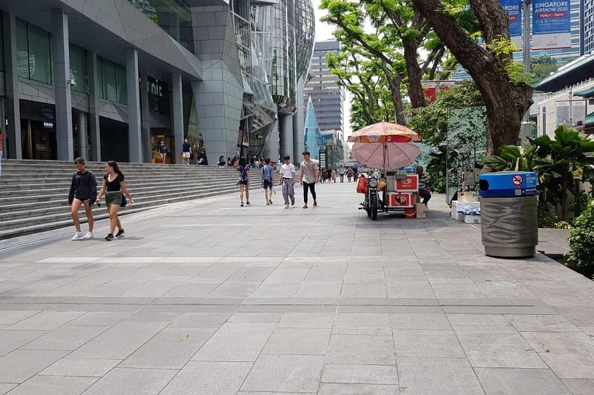 People walking along Orchard Road on Feb 16, 2020.