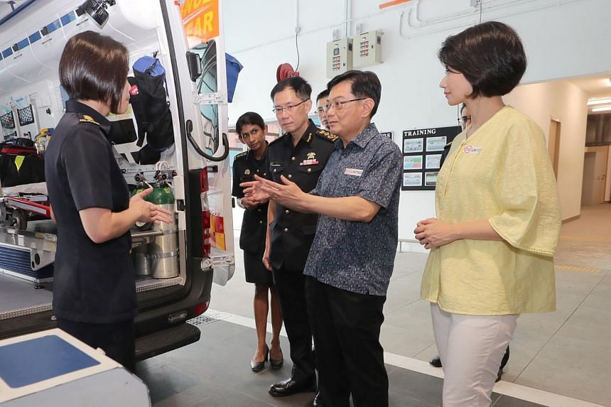 Deputy Prime Minister Heng Swee Keat (centre) speaking to SCDF personnel at Kallang Fire Station, on Feb 16, 2020.