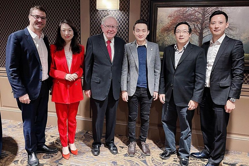 Mr Justin Sun (centre, in light grey jacket) sat down for a $6 million auctioned charity meal with investment guru Warren Buffett, along with guests (from left) Yoni Assia, Helen Hai, Charlie Lee and Chris Lee