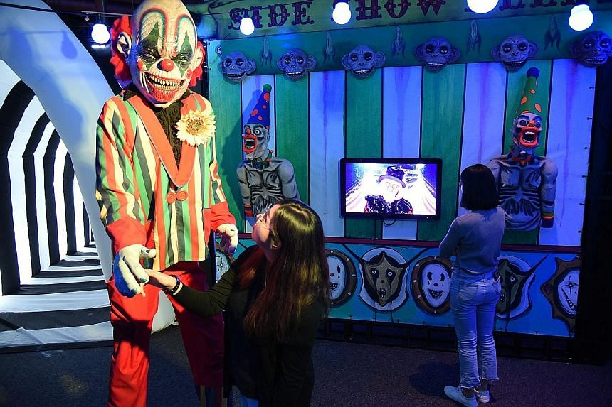 At Phobia²: The Science Of Fear, an exhibition on fear and its effect on people's daily lives, there are life-sized clowns (above) and a scream scene booth.