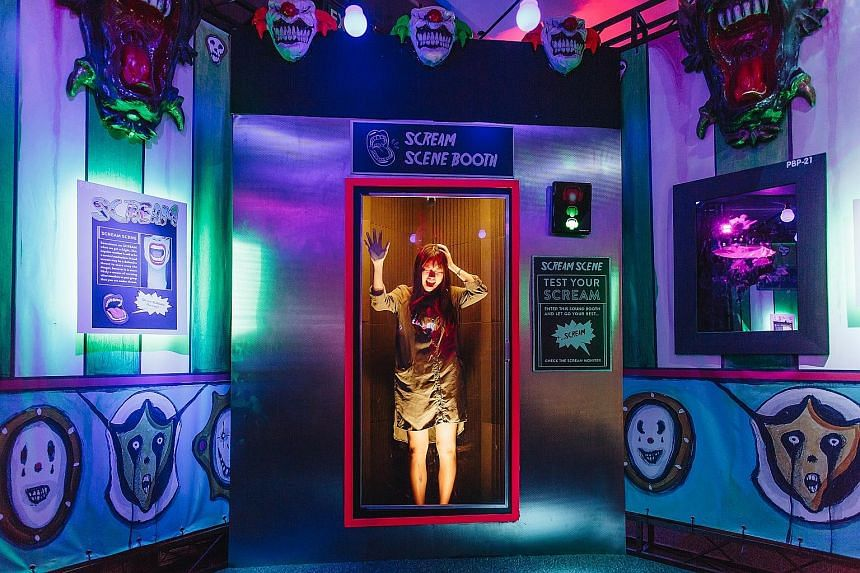 At Phobia²: The Science Of Fear, an exhibition on fear and its effect on people's daily lives, there are life-sized clowns and a scream scene booth (above).