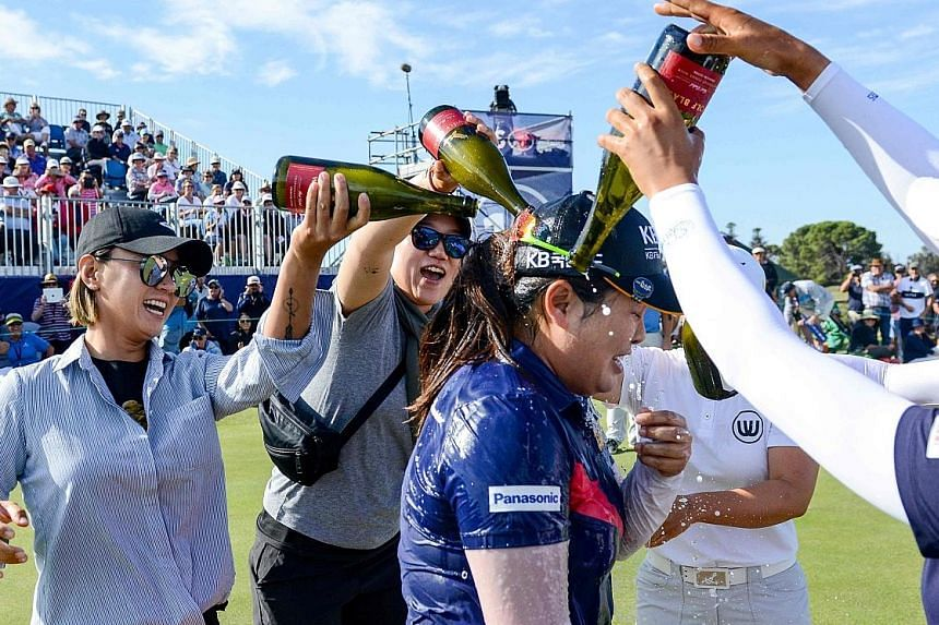 South Korea's Park In-bee getting a champagne shower after the Women's Australian Open win, her first title in two years. PHOTO: AGENCE FRANCE-PRESSE