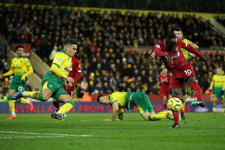 Liverpool substitute Sadio Mane rifling home to break the deadlock with what proved to be the match-winner against Norwich at Carrow Road in the Premier League on Saturday. It was his 100th goal in English football. PHOTO: REUTERS