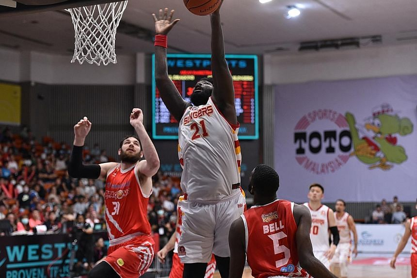 Singapore Slingers centre Anthony McClain scored 14 points despite playing with an injured foot against the Dragons in Kuala Lumpur yesterday. It was his tip-in of Xavier Alexander's missed free throw that sealed the 88-87 Asean Basketball League win