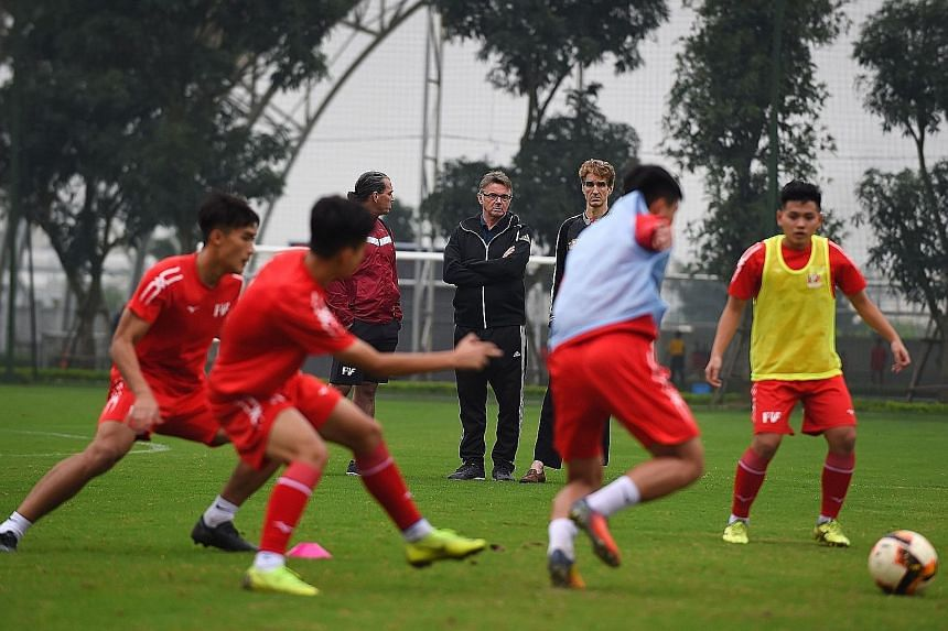 Vietnam's push to qualify for the World Cup will rest on these young players training under the tutelage of PVF academy's technical director Philippe Troussier (centre). PHOTO: AGENCE FRANCE-PRESSE