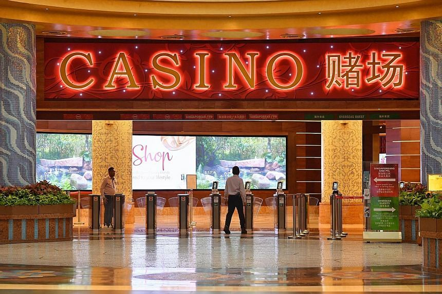 At Resorts World Sentosa's casino (above), visitorship has dived amid the coronavirus outbreak. It has implemented measures such as regular disinfection of gaming chips, tables and slot machines. ST PHOTO: CHONG JUN LIANG